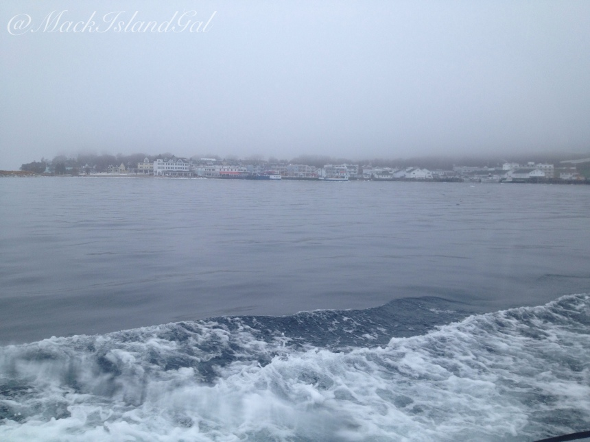 A look back at the island with the fog descending down on it